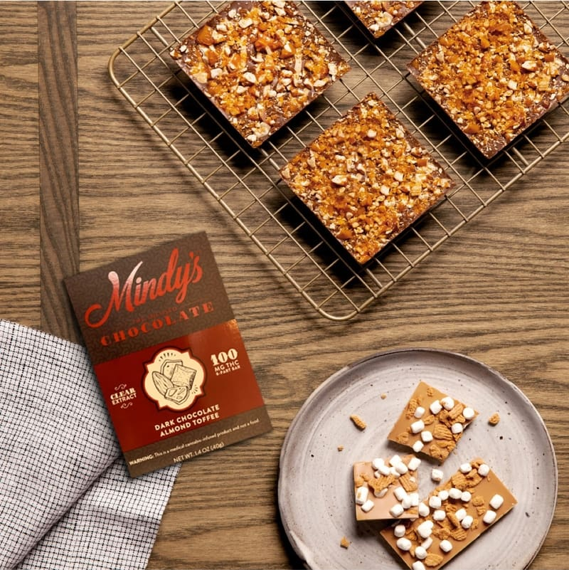 Mindy's chocolate pack on table with brownies