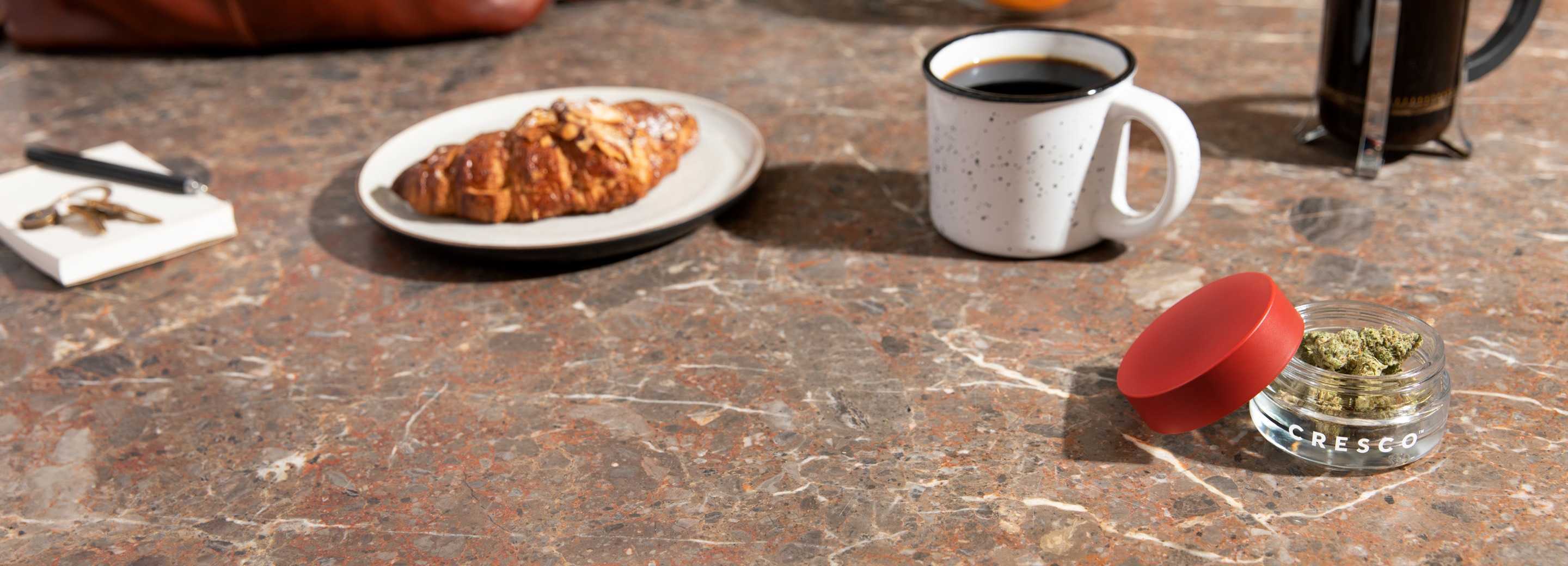Cresco™ jar on counter with coffee and croissant