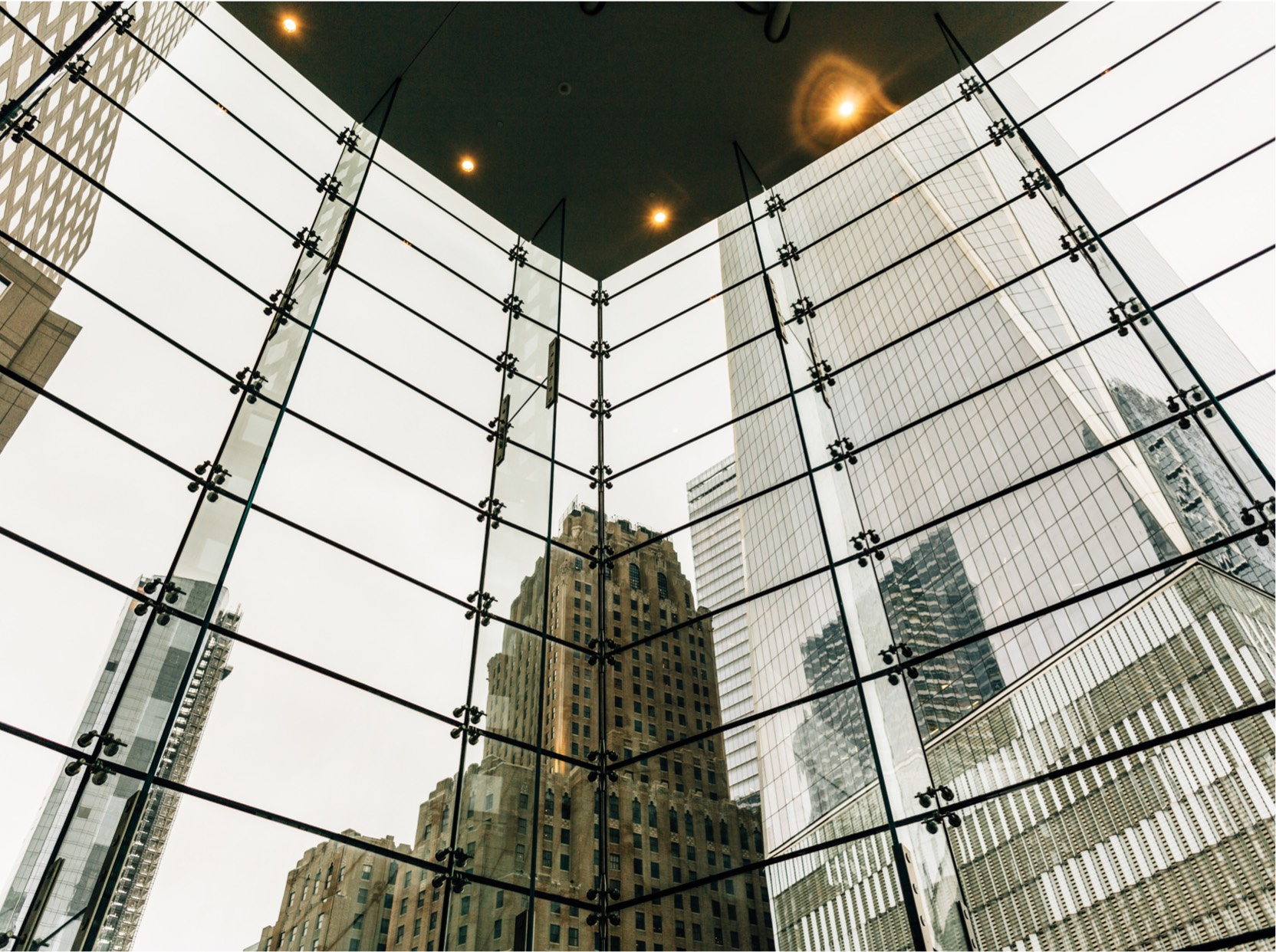 Reflections of buildings on glass